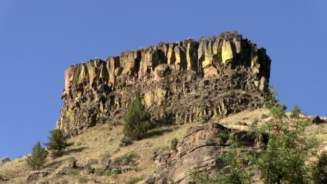 Desert cliff mountain formation with sunshine zoom out video