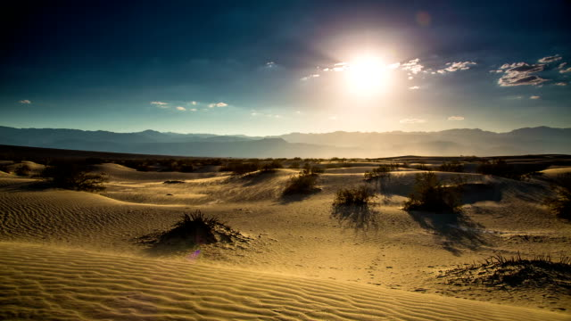 Desert Death Valley Wind blowing Sand over Mesquite Dunes at Death Valley National Park California USA.  mojave desert stock videos & royalty-free footage