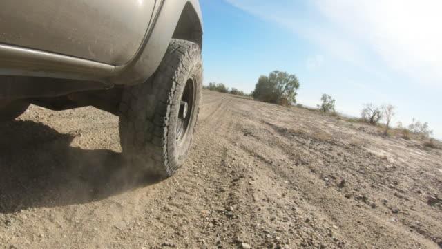desert driving - truck tire video stock e b–roll