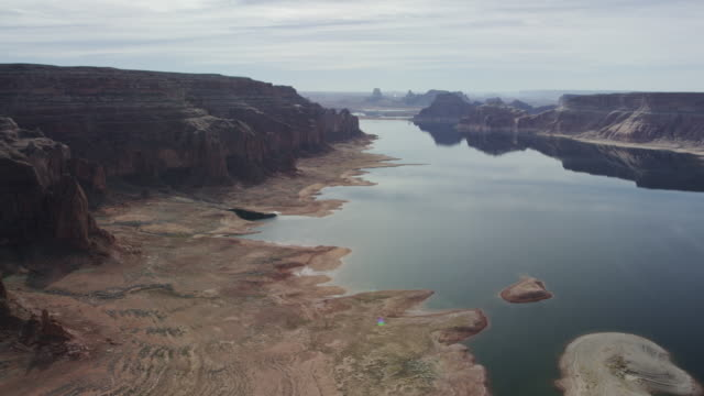 Desert formations of Lake Powell in Arizona and Utah Lake Powell rock formations Arizona and Utah desert river aerial view. western usa stock videos & royalty-free footage