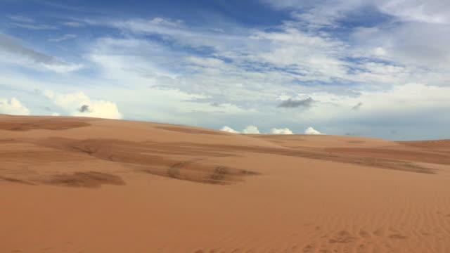 Desert landscape. Sahara winds blowing sand. Arid and dry landscape of desert. Blowing sand in mountain dunes video