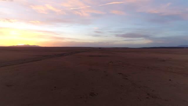 Desert road at sunset
