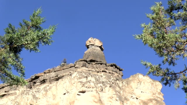 Desert rock peak cliff formation zoom out video