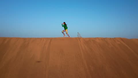 Desert run. Aerial view Woman jogging on a sand dune. Drone point of view hill stock videos & royalty-free footage