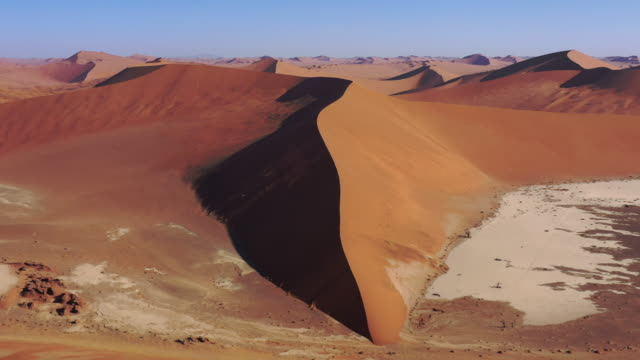 Desert Sand Dune Namibia Dead Vlei Sossusvlei Namb Desert Drone 4K Flight Video Sossusvlei - Dead Vlei Namb Desert Sand Dunes. Drone Aerial Video 4K Round Flight in warm Dusk light along giant Desert Sand Dune in the Namib-Naukluft National Park. Sesriem, Namib-Naukluft National Park, Namibia, South West Africa. swakopmund stock videos & royalty-free footage