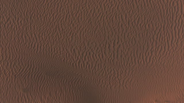 Desert sands shot vertically from above