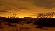 istock Desert Sunset Timelapse gives way to amazing night sky stars 473389671