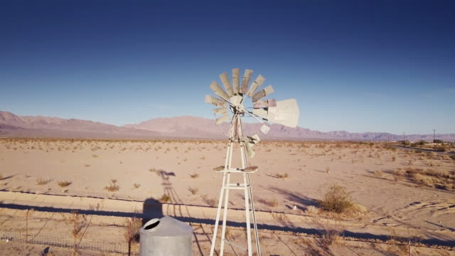 Desert Windmill and Water Tank - Drone Shot video