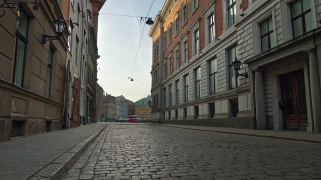 Deserted city due to quarantine, coronavirus effects. Walking  alone along the cobbled street of Old Riga at dawn, Latvia