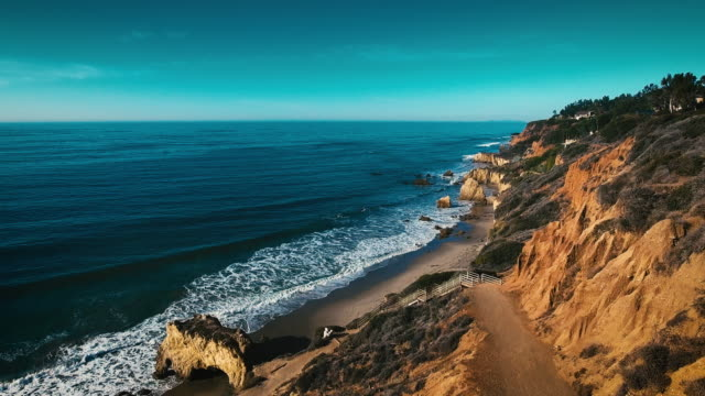 deserted wild el matador beach malibu california aerial ocean view - waves with rocks - california video stock e b–roll