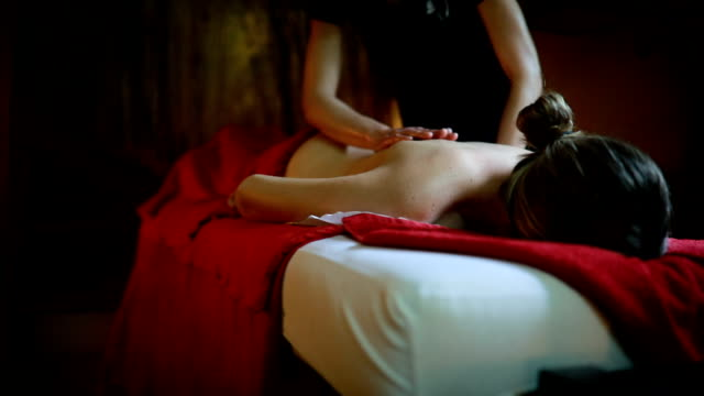 Deserved relaxation in spa center Young woman relaxing in spa center after exhausting day at work massage oil stock videos & royalty-free footage