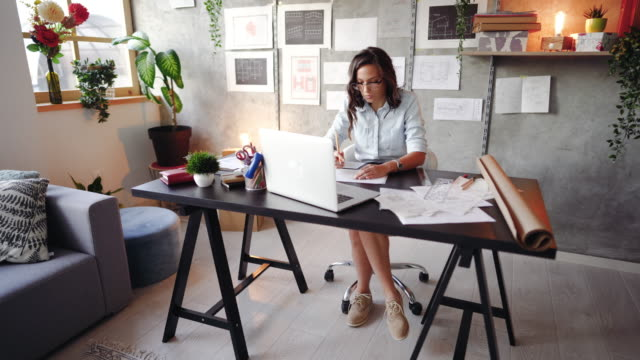 Design is her passion Determined busy woman working on new architectural project in her modern  office studio workplace stock videos & royalty-free footage