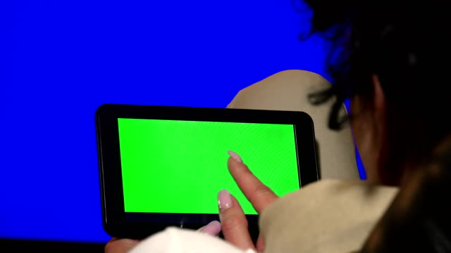 Designer business woman using Digital Tablet with Green Screen in Landscape, UHD stock video, alpha luma matte included video