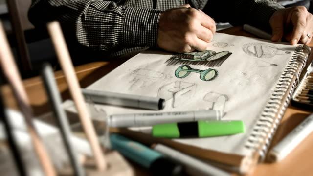 Designer Drawing And Sketching