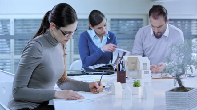 Designer working on new ideas in meeting room video