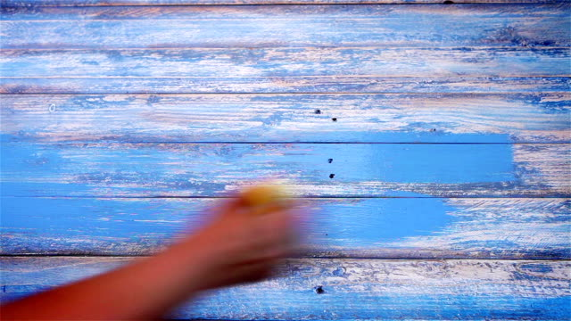 Designer works on a stylish DIY wooden board to use as a background video