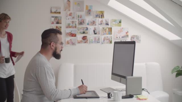4K: Designers Collaborating In Their Graphic Design Studio. video