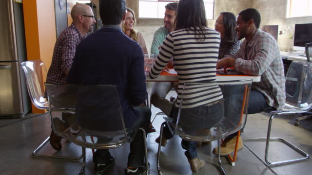 Designers Having Meeting Around Table In Office Shot On R3D video