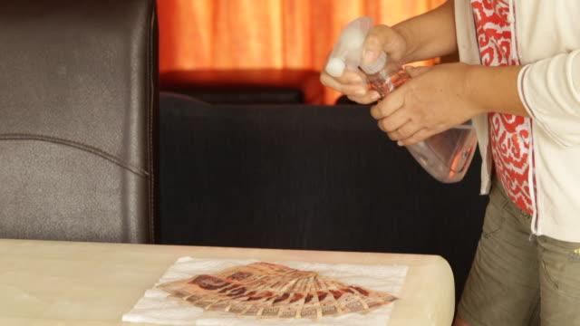 desinfecting objekt - dirty money bildbanksvideor och videomaterial från bakom kulisserna