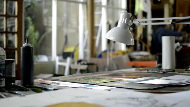 Desk lamp and art studio desk. video