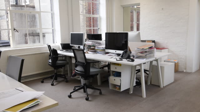 Deskspace with computers in modern office video
