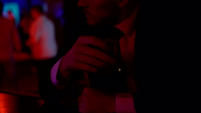 Desperate man drinking too much alcohol in bar alone, problems in private life video