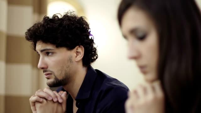 desperate man praying in a church video
