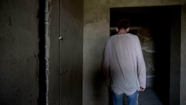 Desperate man walks on abandoned building video