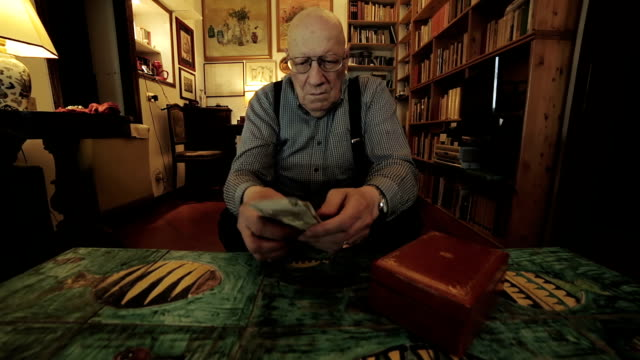 desperate senior man counting money: bad surprise, poor, hide, lonely, old, few video