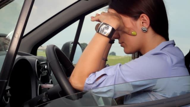 Desperate young businesswoman in traffic jam video