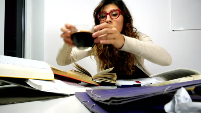 Desperated tired student trying to learn at home