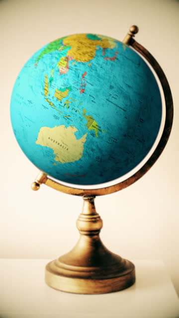 Destination Indonesia & South Pacific: globe spins fast then stops to show the countries of Indonesia & South Pacific
