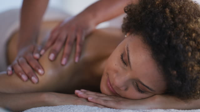 De-stressing after a stressful day at the office 4k video footage of a young woman getting a massage at a spa massage stock videos & royalty-free footage