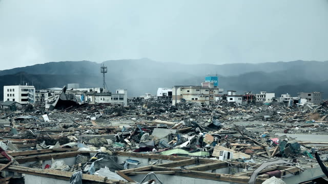 Destroyed Fukushima after the tsunami Destroyed buildings and houses after the tsunami in Japan. City of Fukushima is ravaged after the disaster. No one in the town, an evacuate city. A lot of dust and trash. earthquake stock videos & royalty-free footage