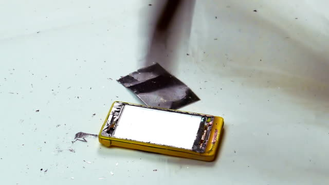 Destruction of a Cell Phone with a Hammer video