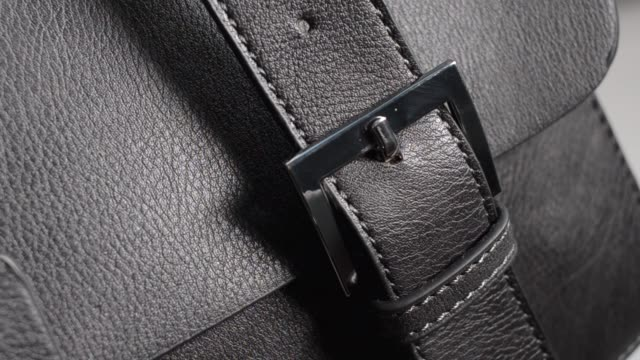 detail from a female handbag. black natural or artificial leather - cucitura video stock e b–roll