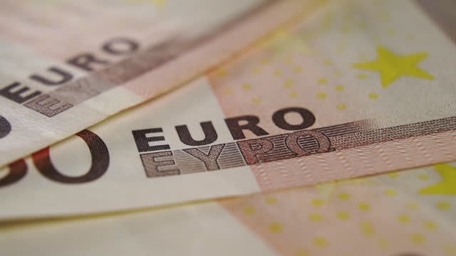 Detail of a fifty euro banknote. Close-up currency text symbol