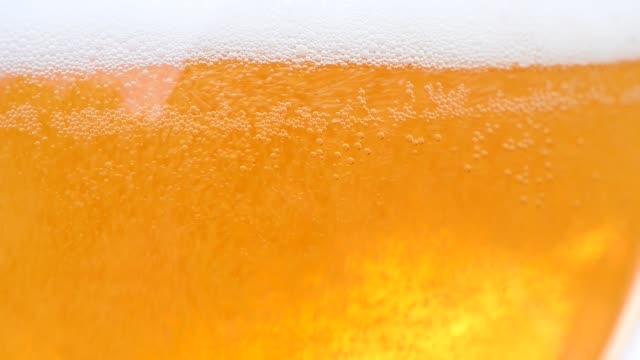 detail of beer glass,rising bubbles - tap water filmów i materiałów b-roll