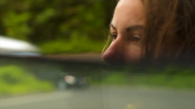 Detail of female driver looking in rear view mirror Nature experiences in Hawaii rear view mirror stock videos & royalty-free footage