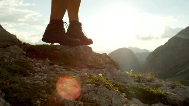 close up: detail of leather boots and hiker walking on dangerous mountain ledge - trekking video stock e b–roll