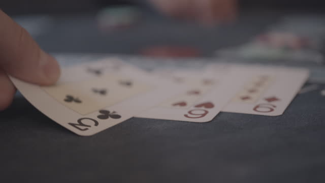 detail of player's hands gambling in casino playing black jack - gioco d'azzardo video stock e b–roll