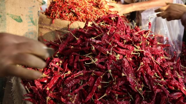 Detail of red hot chillies at market