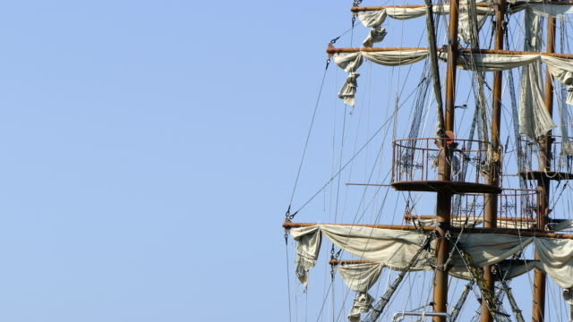 Detail of sail mast Detailed pirate mast and sails rocking in the wind on a bright day mast sailing stock videos & royalty-free footage