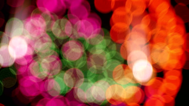 Detail of unfocused fireworks. Many explosions of multicolored unfocused fireworks, that become circles in movement.4k resolution.Bokeh effect. pyrotechnic effects stock videos & royalty-free footage