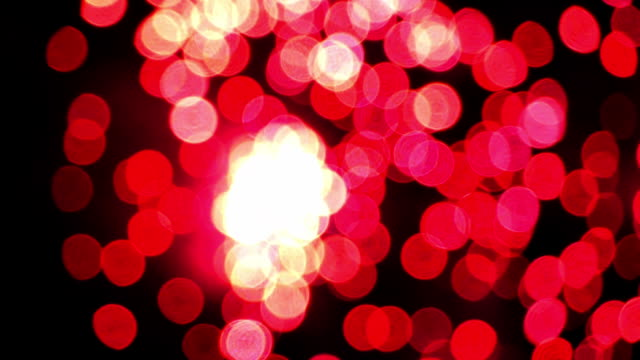 Detail of unfocused fireworks.Slow motion video