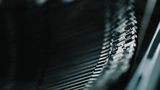 Detail of vintage typewriter metallic letters video
