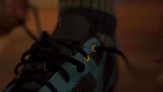 Detail shot of a cyclist tying their shoes