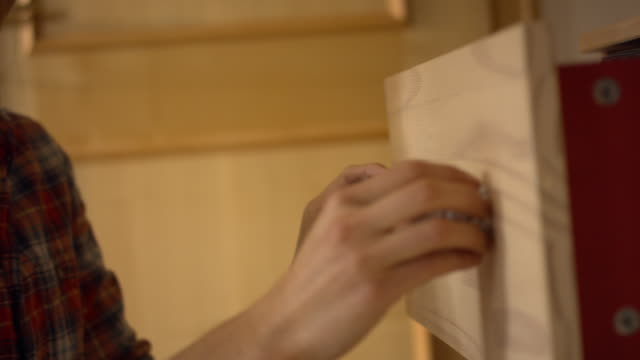 detail shot of a young woman opening a clothes drawer - эскапизм стоковые видео и кадры b-roll