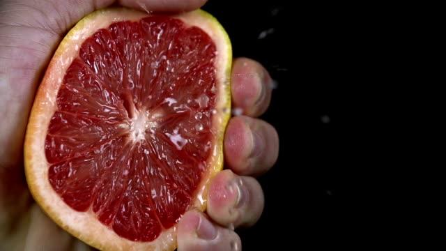 HD SLOW: Detail shot of man squeezin the grapefruit video