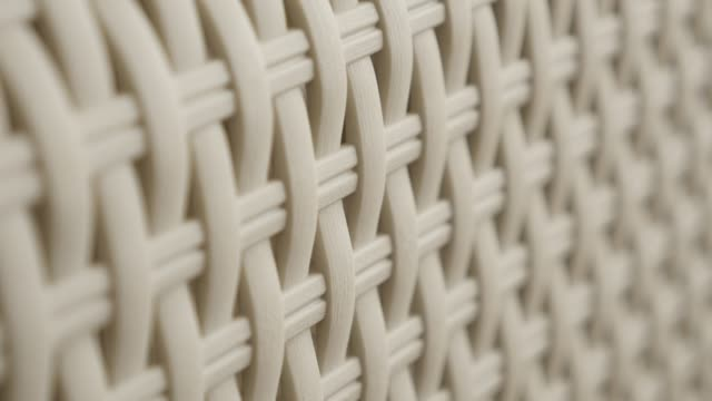 Detailed artificial rattan material surface slow pan 4K
